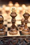 Chessboard with chess on a wooden bench. Royalty Free Stock Photos