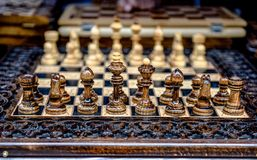 Chessboard with chess on a wooden bench. Royalty Free Stock Photography
