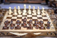 Chessboard with chess on a wooden bench. Stock Images