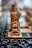Chessboard with chess on a wooden bench. Stock Photo