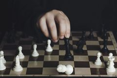 Chessboard. Hand of a boy playing chess Stock Photo