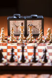 Chessboard, clock and figures Stock Photos
