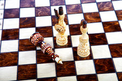 Chessboard with decorative chessmen Royalty Free Stock Images
