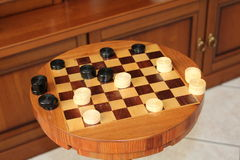 Chessboard and draughts Stock Photos