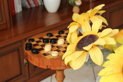Chessboard and draughts Royalty Free Stock Photo