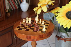 Chessboard and draughts stock image