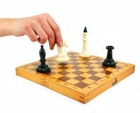 Chessboard and female hand gives check. Isolated on a white background Royalty Free Stock Photos