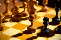 Chessboard with figures. On dark background Royalty Free Stock Photos
