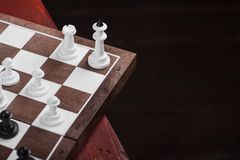Chessboard with figures. On a wooden red table. Chess game concept Stock Images