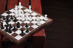Chessboard with figures. On a wooden red table. Chess game concept Stock Photography