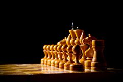 Chessboard with figures. On dark background Stock Image