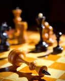 Chessboard with figures. On dark background Stock Images