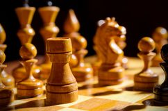 Chessboard with figures. On dark background Stock Photo