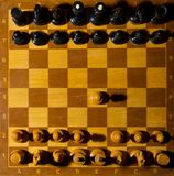 Chessboard with figures. On dark background Royalty Free Stock Image