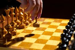 Chessboard with figures. On dark background Stock Photos