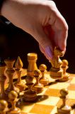 Chessboard with figures. On dark background Royalty Free Stock Images