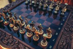 Chessboard with figures. Expensive high-quality chessboard with figures Stock Image