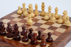 Chessboard with figures in progress isolated Stock Photography