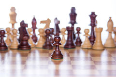 Chessboard with the focus on the pawn standing in the front. Beautiful chessboard with chessfigures in the back and a focused pawn in the front Royalty Free Stock Images