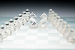 Chessboard glass duel horses Royalty Free Stock Photography