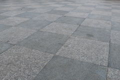 Chessboard. Granite paving two shades mounted interleaved Stock Photography