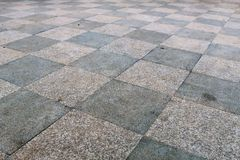 Chessboard. Granite paving two shades mounted interleaved Royalty Free Stock Image