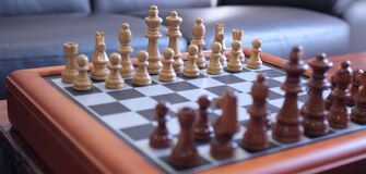 Chessboard in living room Stock Photos