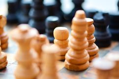Chessboard. a macro shot of chess. focus on the pawn Stock Photos