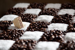 Chessboard made of coffee and sugar with waffle Royalty Free Stock Photography