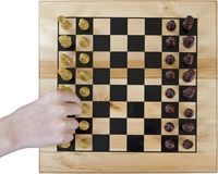 Chessboard with one hand Stock Photography