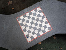 Chessboard painted on a stone bench Royalty Free Stock Photos