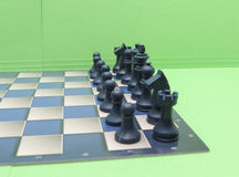 Chessboard with plastic checkers Stock Photos