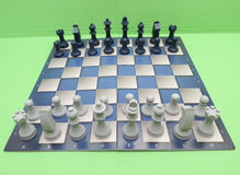 Chessboard with plastic checkers Stock Photo