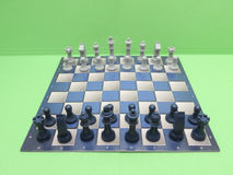 Chessboard with plastic checkers Royalty Free Stock Image