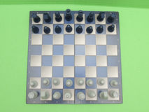 Chessboard with plastic checkers Royalty Free Stock Photography