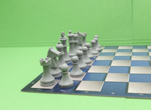 Chessboard with plastic checkers Royalty Free Stock Images