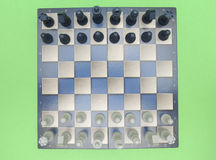 Chessboard with plastic checkers Stock Image