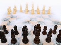 Chessboard in snow Stock Photography