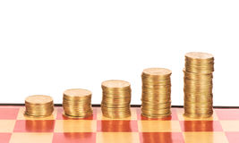Chessboard with stacks of pennies Stock Images