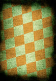 Chessboard style vintage background. With dark edges Royalty Free Stock Photo