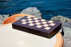 CHESSBOARD on a table Stock Photo