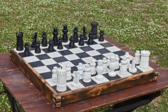Chessboard on table outdoors Stock Images