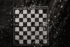 Chessboard under the rain Royalty Free Stock Photos