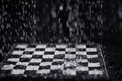 Chessboard under the rain Royalty Free Stock Image