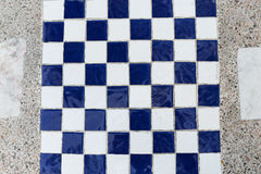 The chessboard. White and blue background Royalty Free Stock Images