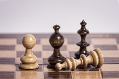 Chessboard with wooden pieces Royalty Free Stock Image