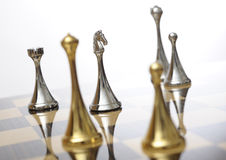 Chessboard with knight in focus Royalty Free Stock Photo