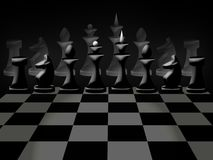 Chessmen on chessboard Stock Photos