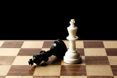 Chessmen on a chessboard. Close-up photography Stock Photos