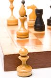 Chessmen on a chessboard Royalty Free Stock Image